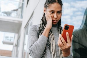 cheater spying - woman looking at text messages