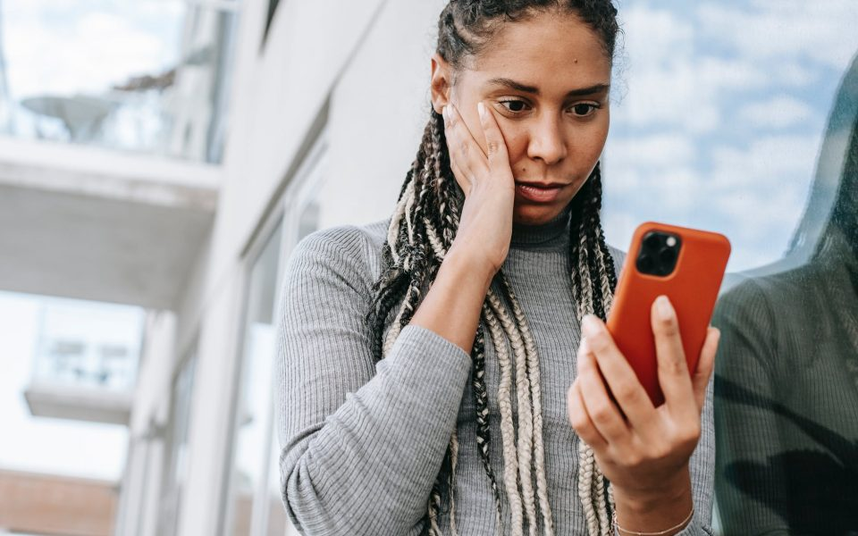 woman looking at text messages